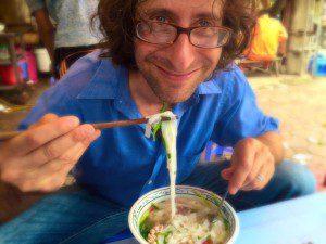 adam eating pho